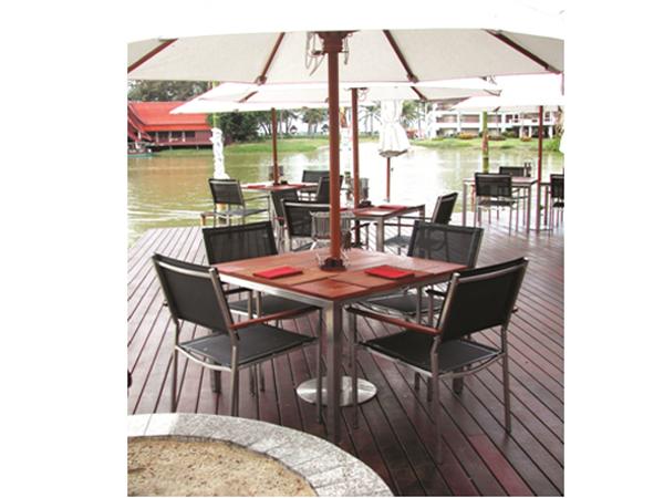 ชุดโต๊ะสนามโครงสแตนเลสหน้าโต๊ะไม้สักทองทรงสี่หลี่ยมจัตุรัสมีช่องเสียบร่มและเก้าอี้โครงสแตนเลสบุผ้าสังเคราะห์เท้าแขนไม้สักทอง TEAKWOOD/STAINLESS STEEL SQUARE TABLE WITH PARASOL HOLE + STACKING ARMCHAIR WITH SYNTHETIC FABRIC